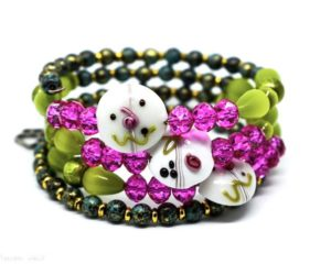 Green and pink beaded bracelet with fun face!