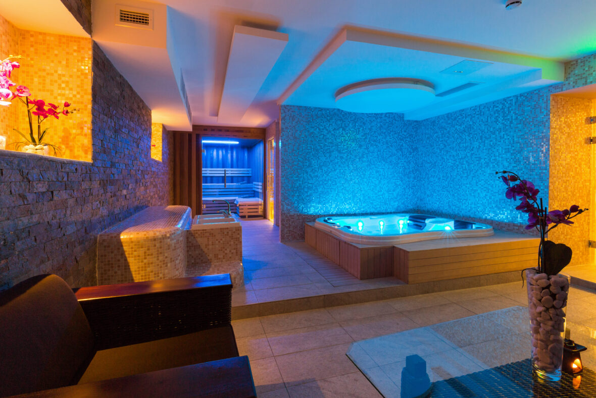 Bathroom with surround sound system and custom lighting