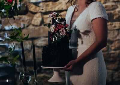 Kitchen Sync wedding - bride holding wedding cake