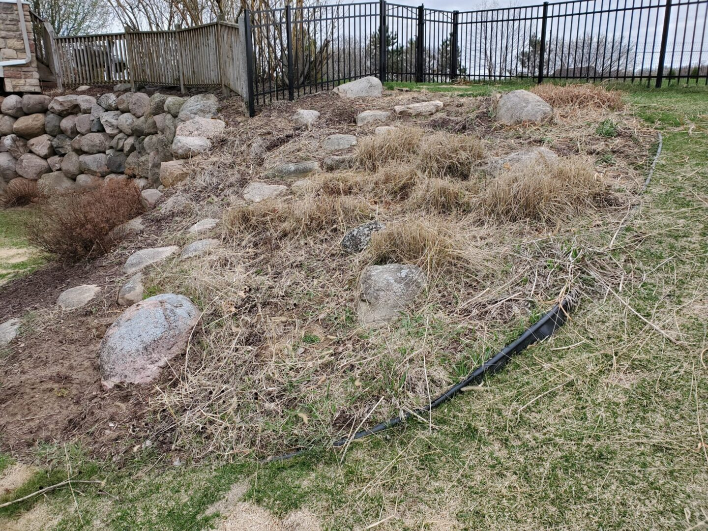 Plastic edging pulls out and grass grows over it