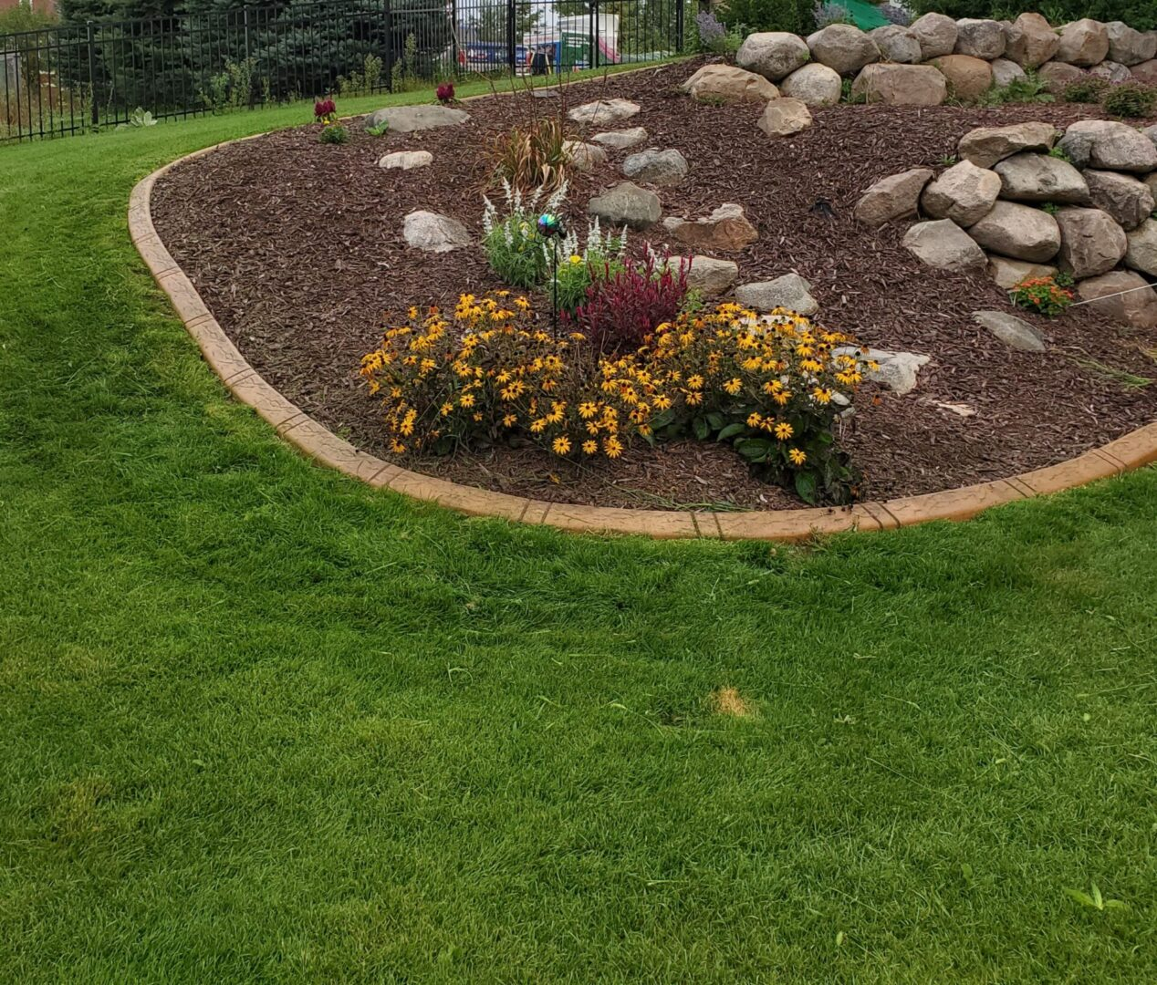 a landscaping project with flowers and stones