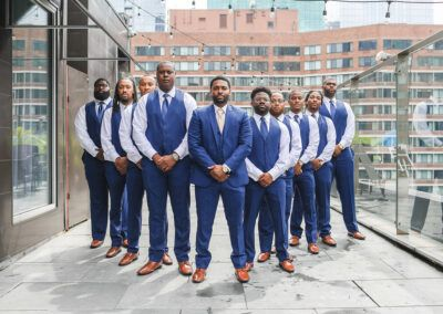 Chicago Wedding Planner SouthWind Events groom and groomsmen in blue suits. Photograph taken by J Lauryn Photography on the rooftop of the Ivy Hotel Chicago.