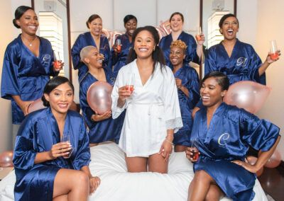 Chicago Wedding Planner SouthWind Events bride and bridemaids in blue robes. Photograph taken by J Lauryn Photography.