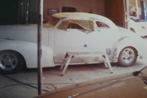 Older Style Car with White Body Paint Ready to Be Repainted