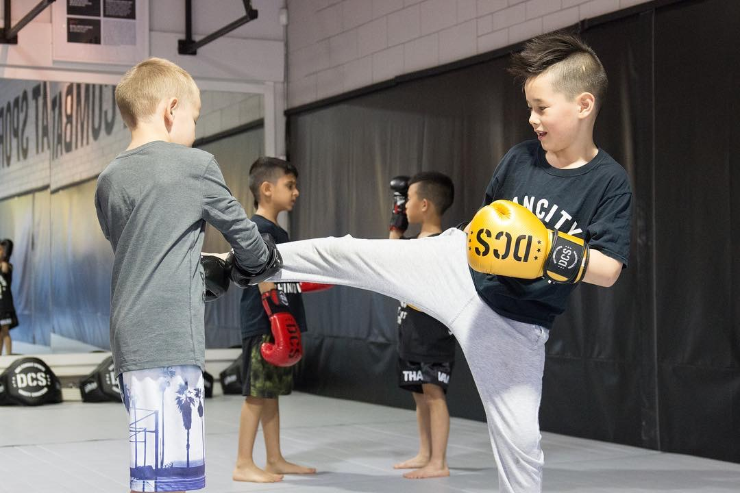 Children practicing kicks in Vancouver BC