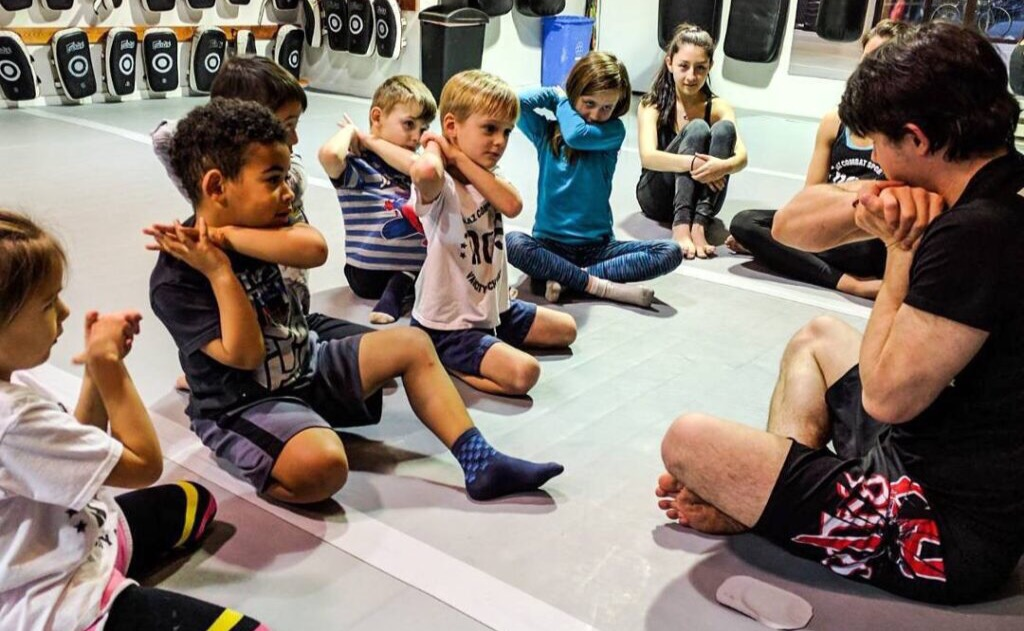 Stretching after kids kickboxing class in Vancouver