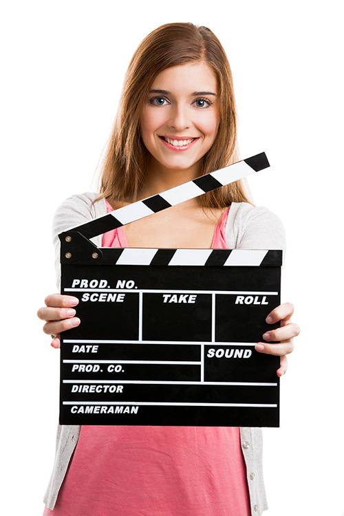 Woman holding clapperboard with smile