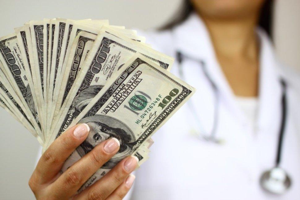 doctor holding money in her hands
