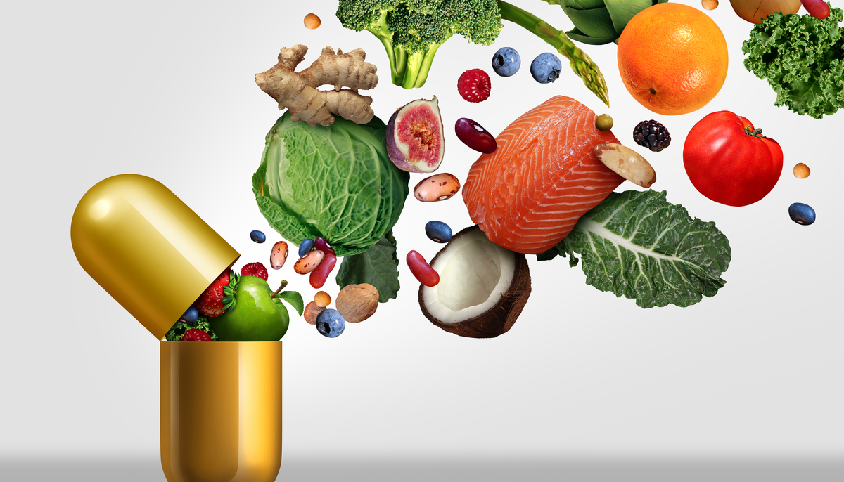 Vitamins supplements as a capsule with fruit vegetables nuts and beans
