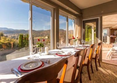 loping Couples are Welcoming to Invite Their Favorite Couple to Join Them for Dinner at A Vista Villa Couples Retreat in Kelowna, BC