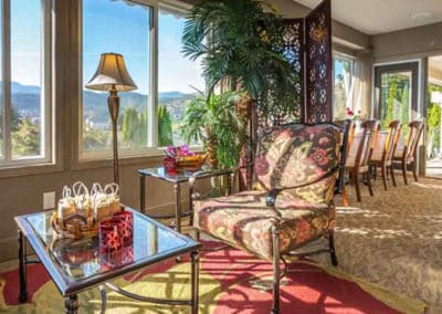 Guests Can Socialize in the Guest Lounge With Sweeping Views of the Lake Okanagan and the City of Kelowna at A Vista Villa Couples Retreat