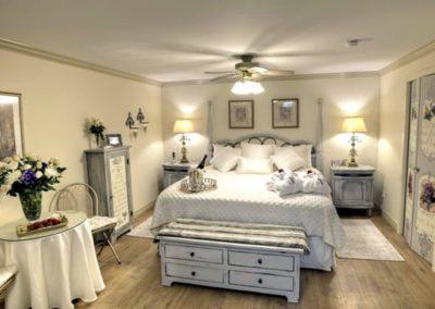 Royal Honeymoon Suite solid pine king-sized bed has a tempurpedic foam mattress topper.