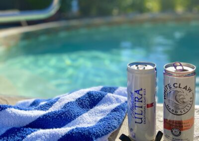 Cold drinks taste so good by the Villa's Salt Water Pool for couples in the sunny Okanagan