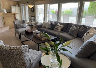 The Spacious Common Living Room is adjacent to the Office Area and Laundry Area at A Vista Villa Couples Retreat in Kelowna, BC