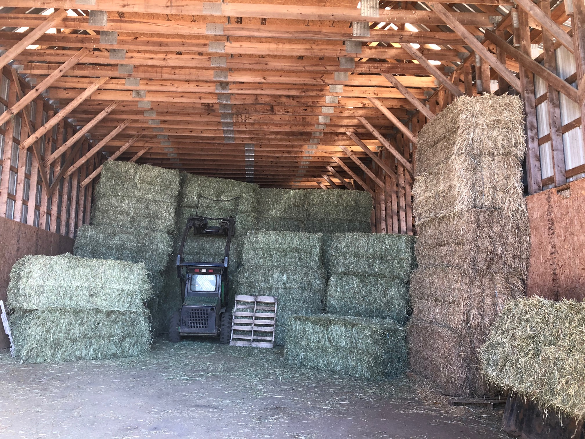 stacked large square hay bales for sale