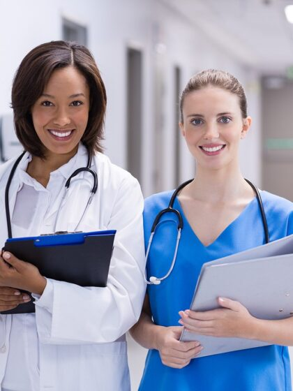 image of two medical providers in a hallway