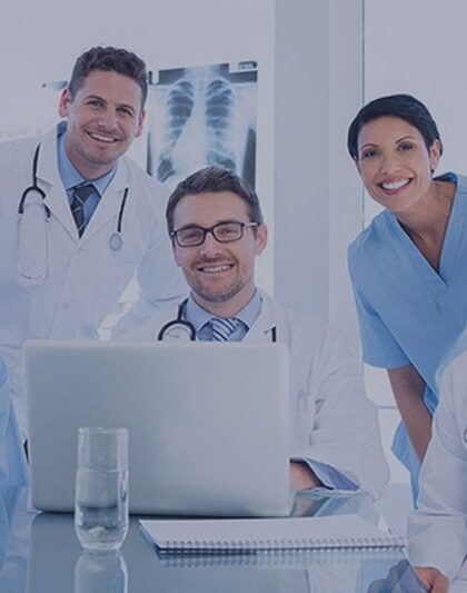 image of five medical providers in front of a computer