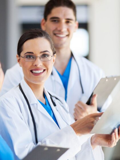 image of three health care providers with clipboards reviewing patient results