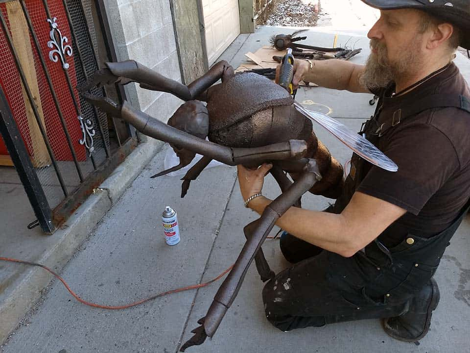 Hraefn Wulfson adding a few final touches to the dead mosquito prop