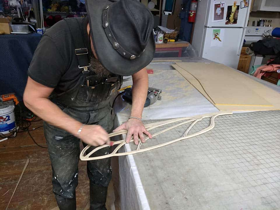 Hraefn Wulfson cuts and sands forms that will be used to vacuform wings for the new custom mosquito mascot