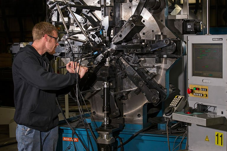 spring manufacturing machine at work
