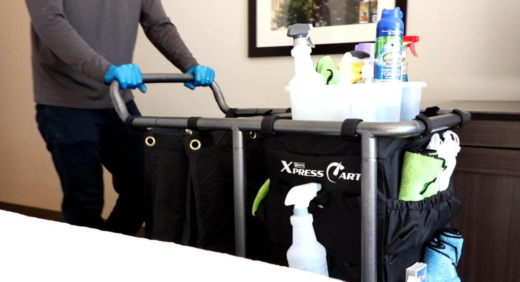 Housekeeper bringing cart into room
