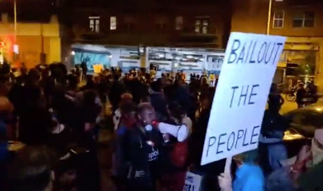 Protesters marching through the streets and shouting Black lives and waving banners reading BLM before the shooting