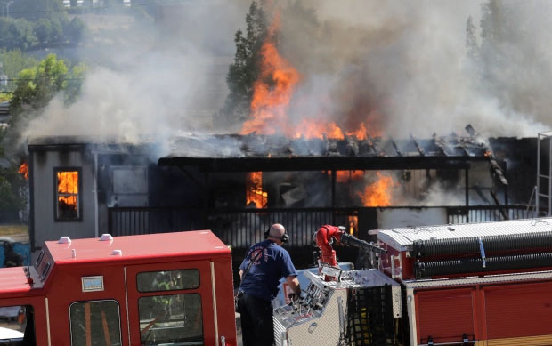Construction buildings burn near the King County Juvenile Detention Center in Seattle.