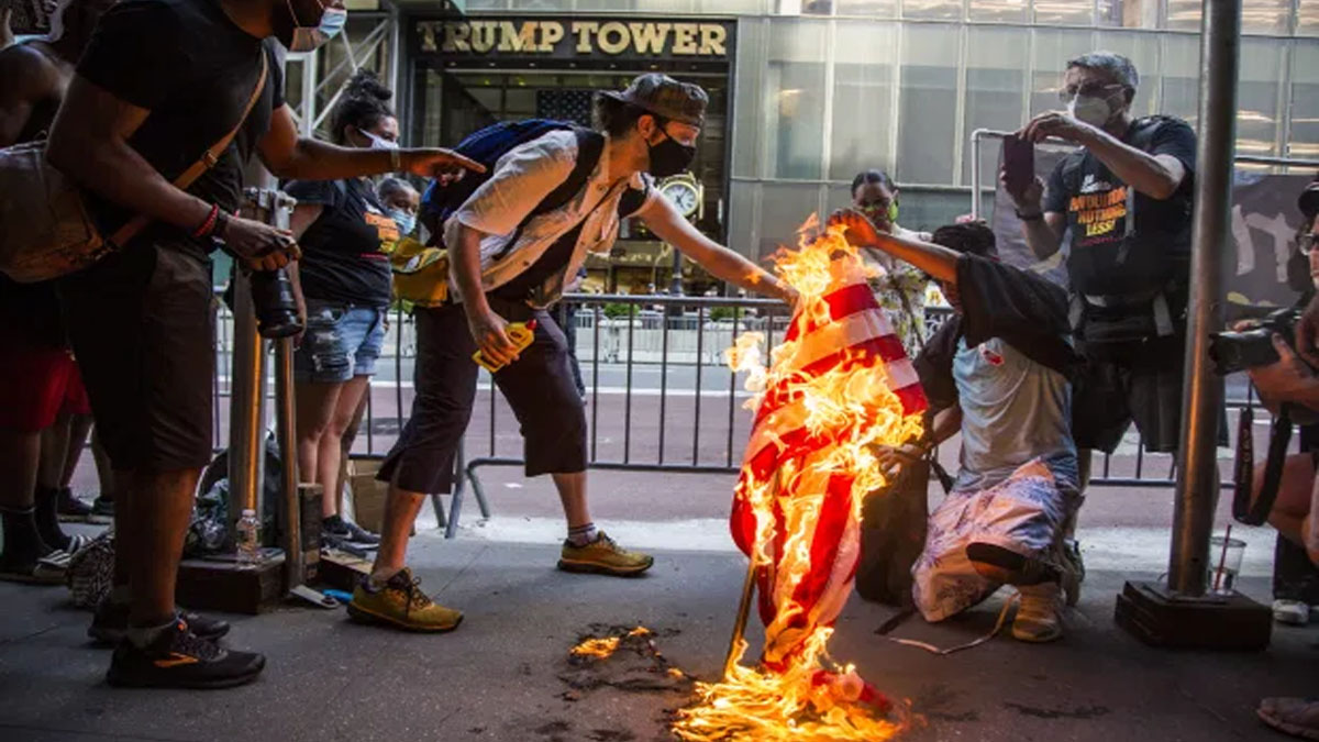 Protesters yell U.S. was never great & burn flag at Trump Tower & White House