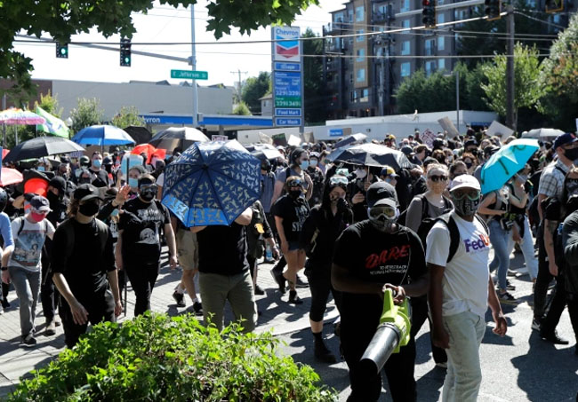 Protesters march near the King County Juvenile Detention Center in Seattle.