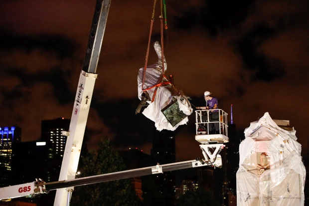The monument was taken down with a large crane early Friday morning in Chicago's Grant Park