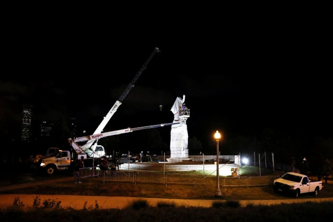 A crane was used to remove the monument