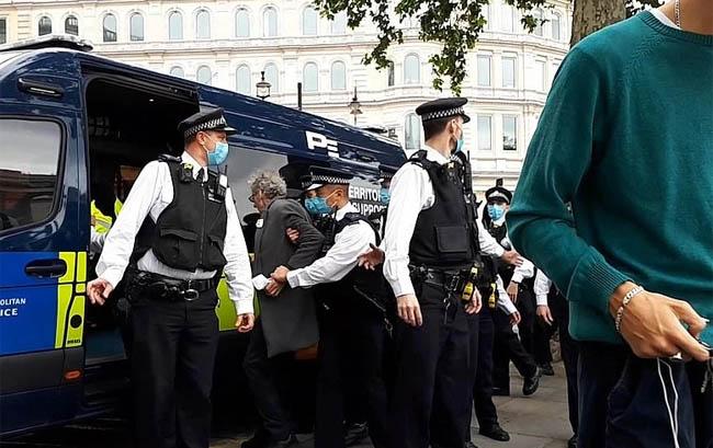 Corbyn was seen being put in a police van