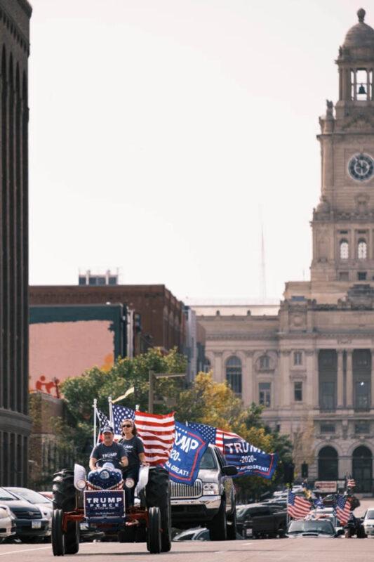 Gary Leffler drives a tractor leading a pro-Trump motorcade in Des Moines. Credit: ZUMA Press, Inc.