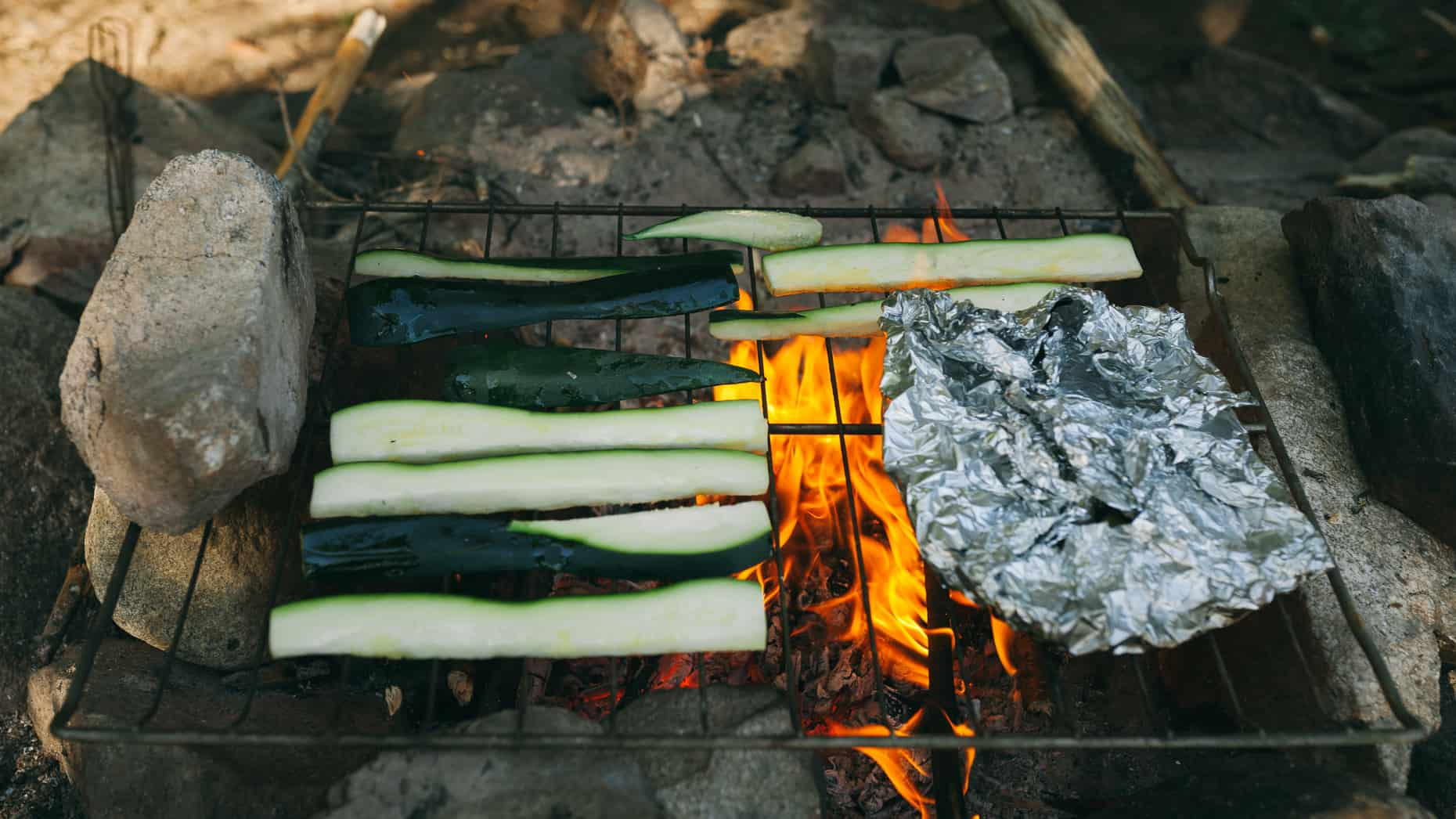 Zucchini cooking on the open fire.