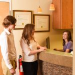 Front Desk: Heather greeting mother and son