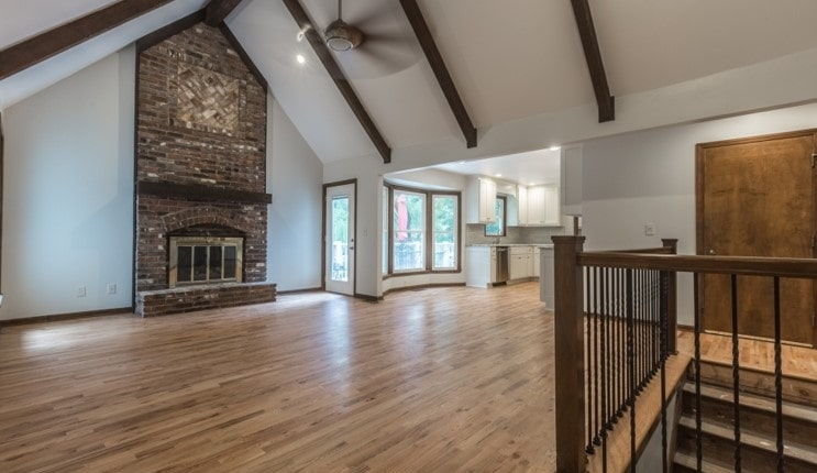 Davis family room, brick fireplace and cathedral ceilings