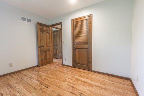 Davis bedroom with newly refinished doors, trim and floors
