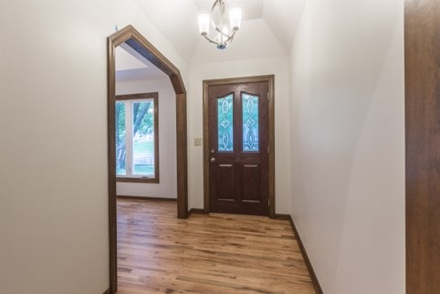 Front entry with new flooring and chandelier in davis home remodel