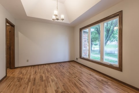 Formal living room with recessed or tray ceiling