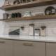 Floating kitchen shelves on tile wall