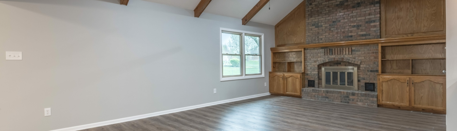 Aker great room with exposed beams