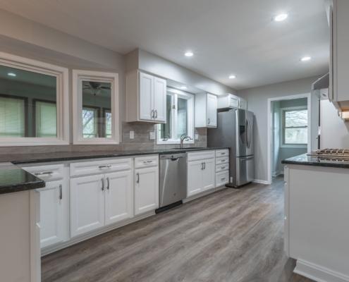 Open kitchen design with grey walls