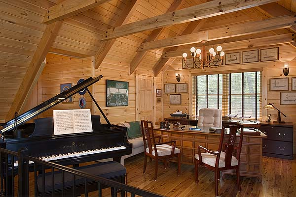 photo of great room area with matching wood exposed beams, ceiling, walls and floors and a built in executive office desk