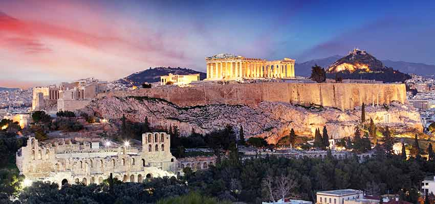 The Parthenon lit up at night on top of the Acropolis