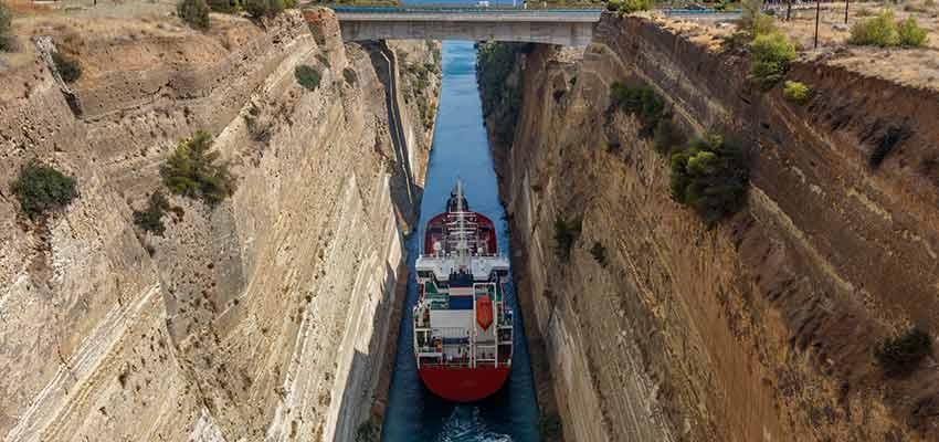 A ship sailing through the Corinth Canal