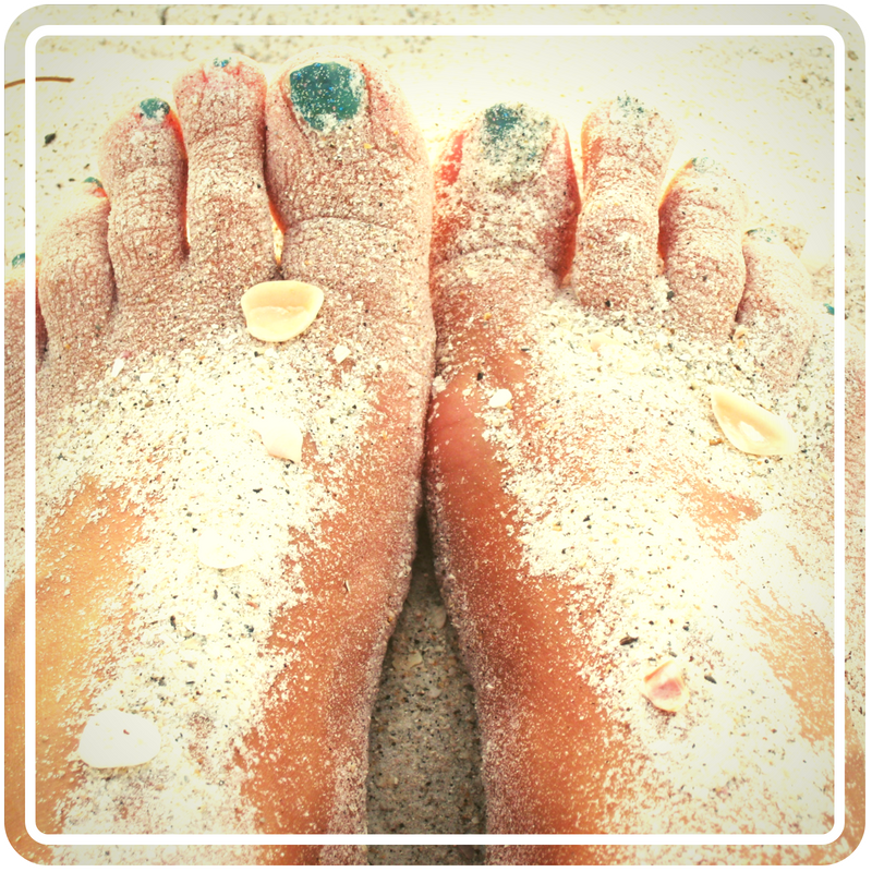 Feet dusted with sand from a beach
