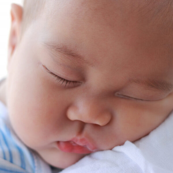 baby asleep on shoulder