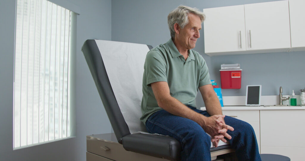 Senior,Caucasian,Male,Patient,Waiting,Patiently,For,Doctor,While,Sitting