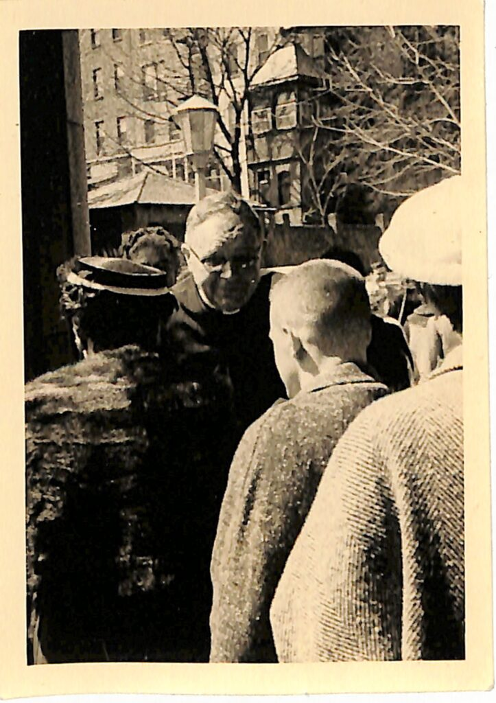 Harold Griffis greeting parishioners